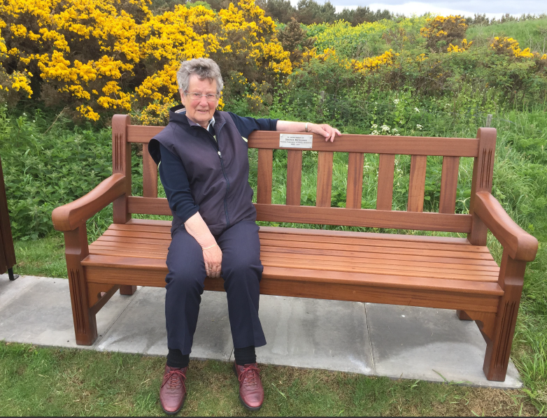 Rena Bethune at memorial bench to Dennis Bethune
